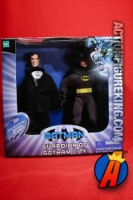 Guardians of Gotham black and grey Batman figure with Bruce Wayne business suit.