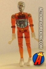 A Micronauts orange TIME TRAVELER action figure from MEGO