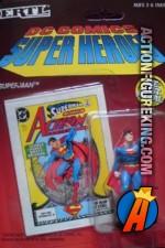 2-inch DC Comics Super-Heroes Die-Cast Metal Superman Raised Fist figure.