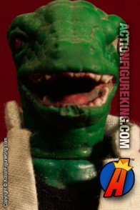 From the pages of Spider-Man comes this Mego 8-inch LIZARD action figure with authentic fabric outfit.