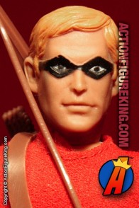 Fully articulated Mego 8-inch Speedy action figure with removable fabric outfit.