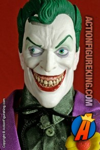 13 Inch DC Direct fully articulated Joker action figure with authentic fabric outfit.