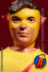 Fully articulated Mego 7-inch Kid Flash action figure with removable fabric outfit.