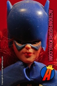 Fully articulated Mego 8-inch Batgirl action figure with authentic fabric uniform.