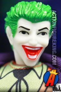 Fully artciulated Retro-Action Joker action figure with authentic fabric outfit.