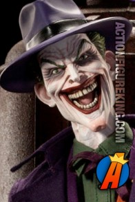 Sideshow Collectibles highly detailed sixth scale Joker action figure with authentic fabric uniform.