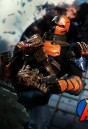 Mezco 6-Inch Scale DC Comics DEATHSTROKE Action Figure with highly detailed cloth uniform.