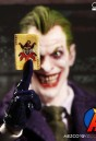 Mezco 1:12 Scale JOKER Action Figure with highly detailed cloth outfit.